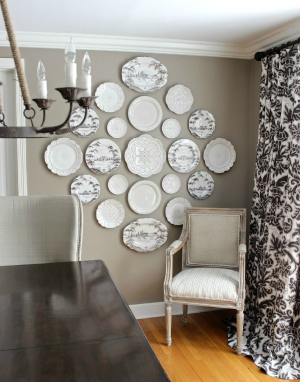 hanging plates on wall dining room with table.jpg